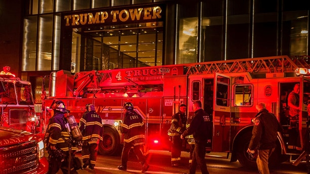 Firefighters work in front of Trump Tower in New York on Saturday, April 7, 2018 after battling a fire. The Fire Department says a blaze broke out on the 50th floor shortly before 6 p.m. Saturday. (AP Photo/Andres Kudacki)
