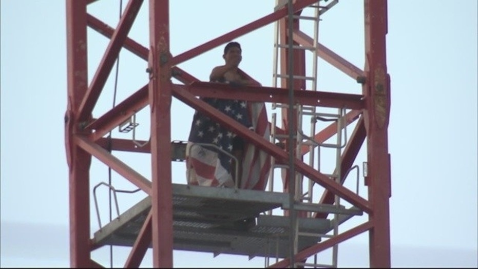 A man was arrested after a three-hour ordeal on a 200-foot crane Sunday.