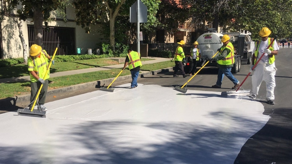 "Officials in Los Angeles are painting streets white to reduce the effect of urban ""heat islands."""