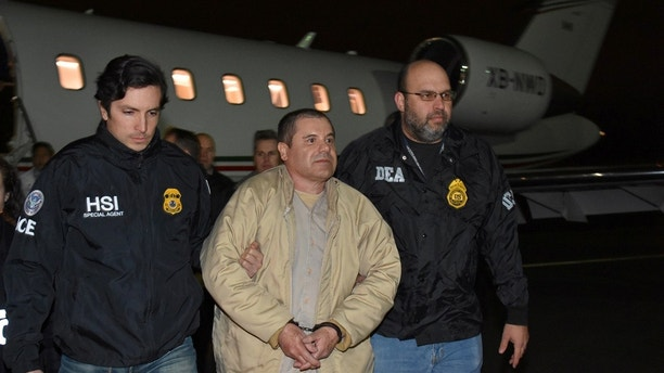 """Mexico's top drug lord Joaquin """"El Chapo"""" Guzman is escorted as he arrives at Long Island MacArthur airport in New York, U.S., January 19, 2017, after his extradition from Mexico. U.S. officials/Handout via REUTERS      ATTENTION EDITORS - THIS IMAGE WAS PROVIDED BY A THIRD PARTY. EDITORIAL USE ONLY.     TPX IMAGES OF THE DAY - RC161C1A9880"""