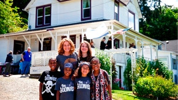 "FILE - This June, 2014, file photo shows some of the Hart family at the annual celebration of ""The Goonies"" movie in Astoria, Ore. A body was recovered Saturday, April 7, 2018, in the vicinity where an SUV plunged off a Northern California cliff last month, killing the family of eight in what authorities suspect may have been an intentional crash. (Thomas Boyd/The Oregonian via AP, File)"