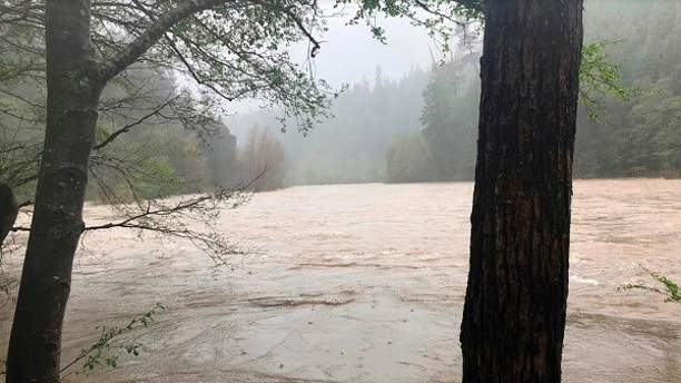 FILE - In this Thursday, April 12, 2018, file photo by The Mendocino County Sheriff's Office shows the Eel River in Northern California. Authorities searching for a family whose SUV plunged into a Northern California river have found the body of a child. Mendocino County Sheriff Thomas Allman says Friday, April 13, 2018, a boat team recovered the deceased juvenile about 7 miles south of where the family's SUV went off U.S. 101 and fell into the rain-swollen Eel River last week. Two children were among the four members of the Thottapilly family of Santa Clarita, Calif., who were reported missing by relatives. (Lt. Shannon Barney/Mendocino County Sheriff's Office via AP, File)