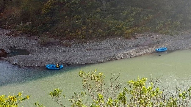 In this Thursday, April 12, 2018, file photo released by The Mendocino County Sheriff's Office shows a search underway along the Eel River in Northern California. Authorities searching for a family whose SUV plunged into a Northern California river have found the body of a child. Mendocino County Sheriff Thomas Allman says Friday, April 13, 2018, a boat team recovered the deceased juvenile about 7 miles south of where the family's SUV went off U.S. 101 and fell into the rain-swollen Eel River last week. Two children were among the four members of the Thottapilly family of Santa Clarita, Calif., who were reported missing by relatives. (Lt. Shannon Barney/Mendocino County Sheriff's Office via AP, File)