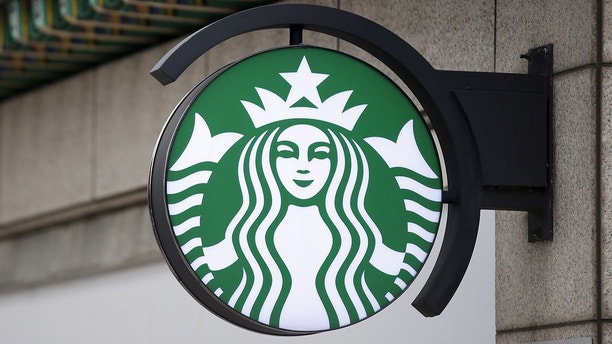 A Starbucks logo is seen at a Starbucks coffee shop in Seoul, South Korea, March 7, 2016. Picture taken March 7, 2016. REUTERS/Kim Hong-Ji - GF10000370755