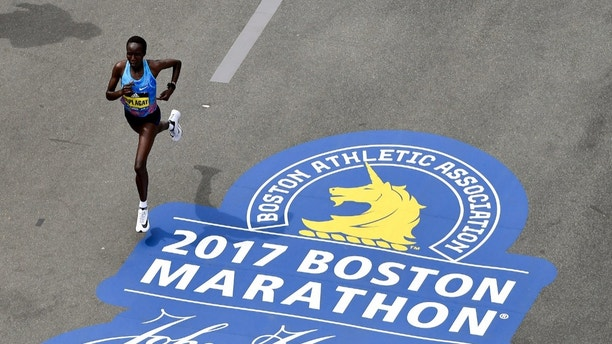 Apr 17, 2017; Boston, MA, USA; Edna Kiplagat runs down Boylston Street towards the finish line of the 2017 Boston Marathon. Kiplagat took first place in the women's division. Mandatory Credit: Brian Fluharty-USA TODAY Sports - 10017335
