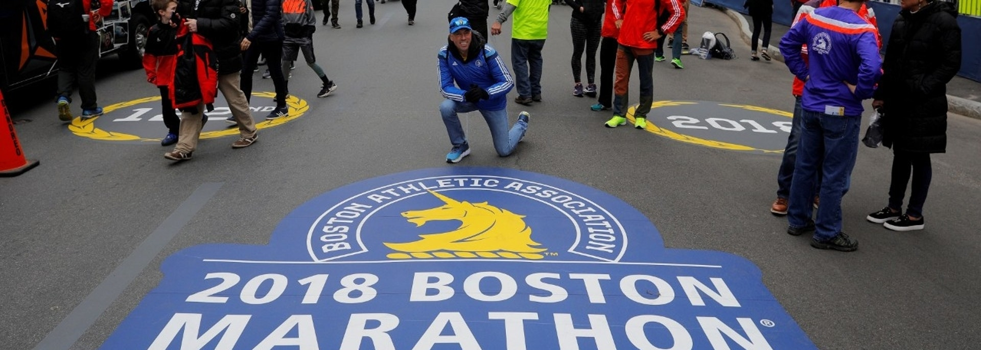 A man poses for a photograph near the finish line ahead of the 122nd edition of the Boston Marathon and the 5th anniversary of the Boston Marathon bombings in Boston, Massachusetts, U.S., April 14, 2018. REUTERS/Brian Snyder - RC1FBD8FE290