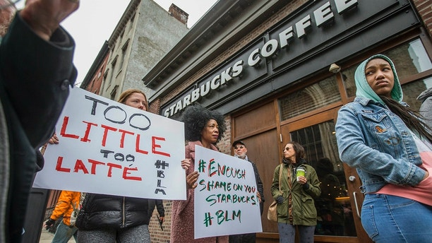 Protesters Gather Outside Of A Starbucks In Philadelphia Sunday April