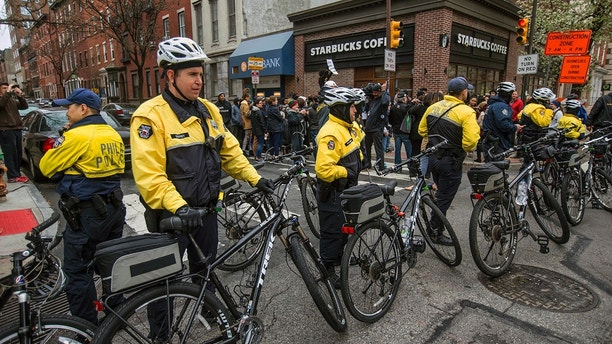 "Philadelphia police form a line in front of the Starbucks that was at the center of a Black Lives Matter protest on Sunday, April 15, 2018. Two black men were arrested Thursday after Starbucks employees called police to say the men were trespassing. The arrest prompted accusations of racism on social media. Starbucks CEO Kevin Johnson posted a lengthy statement Saturday night, calling the situation ""disheartening"" and that it led to a ""reprehensible"" outcome. (Michael Bryant/The Philadelphia Inquirer via AP)"