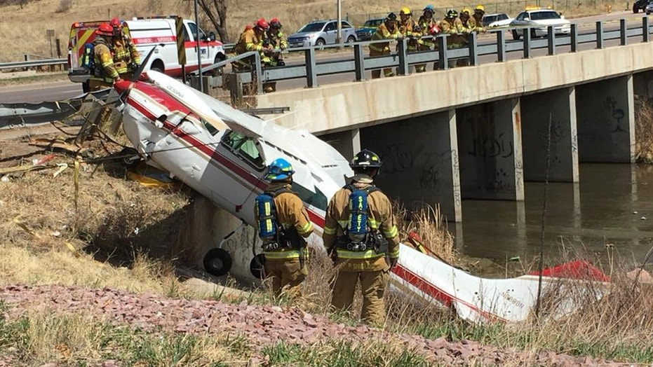 A small plane crashed on a busy road in Colorado Springs, Co. on Sunday.