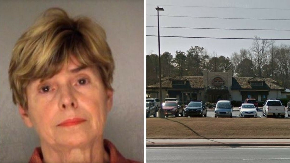 Judy James Tucker was arrested and charged after getting into a spat with two service members over a parking spot outside a restaurant.