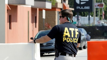An ATF agent sets up a barricade at the scene of the shooting at the Pulse gay nightclub in Orlando, Florida, June 15, 2016.   REUTERS/Jim Young  - S1AETKBKROAA