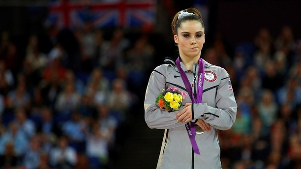 McKayla Maroney of the U.S. celebrates with her silver medal in the women's vault victory ceremony in the North Greenwich Arena during the London 2012 Olympic Games August 5, 2012.  REUTERS/Brian Snyder (BRITAIN  - Tags: SPORT OLYMPICS SPORT GYMNASTICS)   - LM2E88519YPNJ