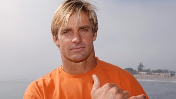 Surfer and event host  Laird Hamilton attends the 'A Day at the Beach Paddle Out Protest' held to show opposition to the nearby construction of a proposed liquid natural gas (LNG) facility in Malibu, California October 22, 2006. REUTERS/Phil McCarten (UNITED STATES) - GM1DTTVTZBAA