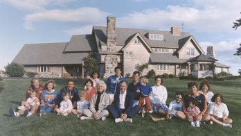 FILE PHOTO 24AUG86 - Portrait of the Bush family sitting in front of their home in Kennebunkport, Maine. BACK ROW: Maragret Bush (Marvin's wife), holding daughter Marshall, Marvin Bush, Bill LeBlond (Doro's Husband). FRONT ROW: Neil Bush holding son Pierce, Sharon (Neil's wife), George W. Bush holding daughter Barbara Bush, George Bush, Sam LeBlond (Doro's son), Doro Bush LeBlond, George P.  CM - RP2DRHZJMAAA