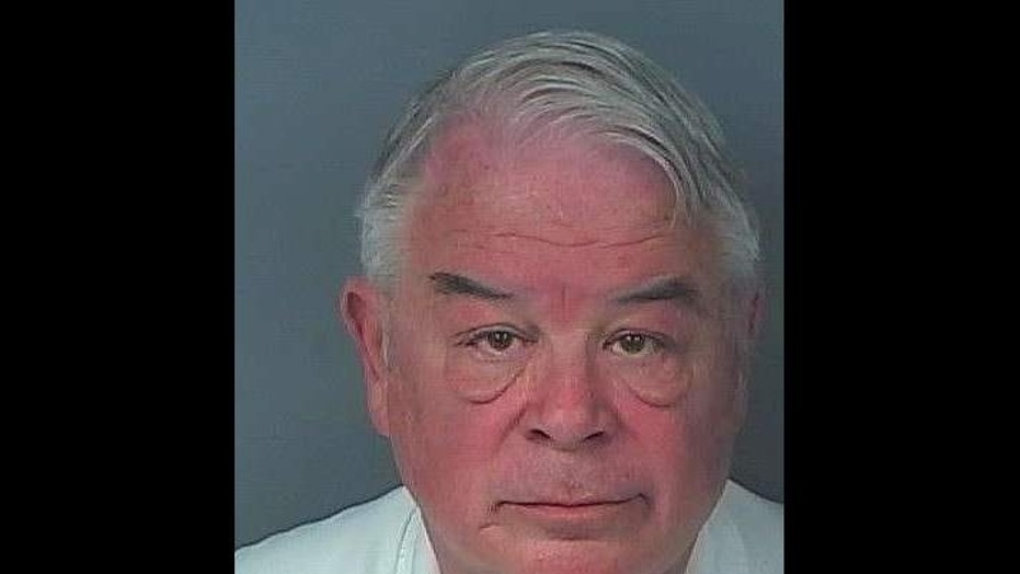 Commissioner Nick Nicholson, 71, was booked into Hernando County Detention Center on charges relating to prostitution, authorities say.