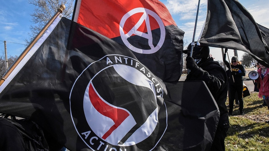 Ten anti-fascist protesters were arrested at a neo-Nazi rally in Georgia after some refused to remove the masks they were wearing at the demonstration.