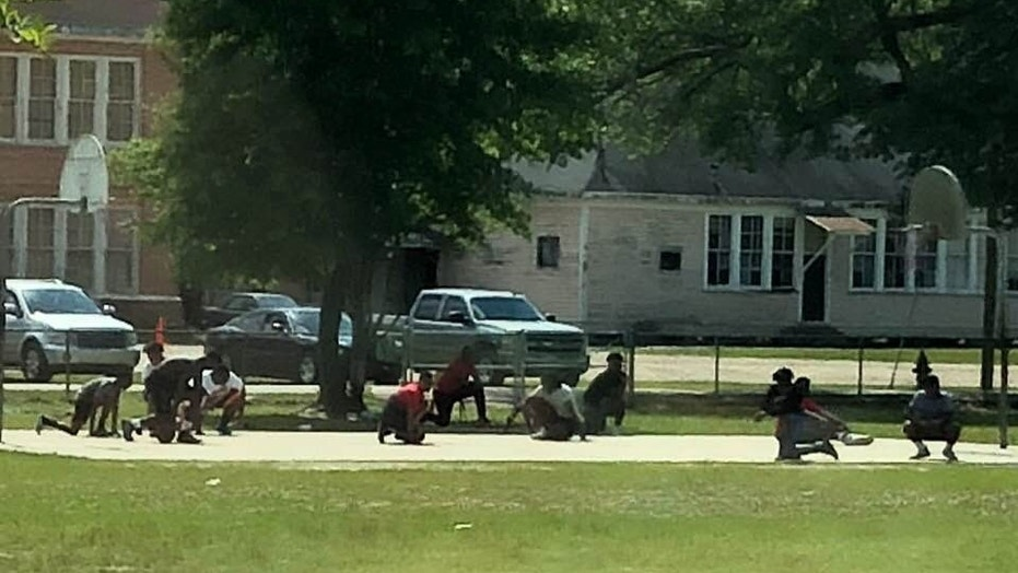 A group of teens dropped to their knees in Franklinton, Louisiana, when they saw a funeral procession passing by.