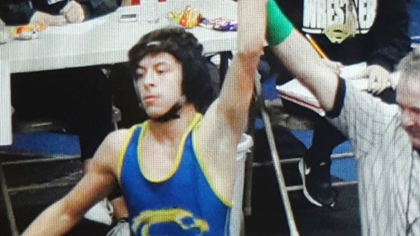 This February 2016 photo provided by team wrestling coach Ray Castellanos, shows high school wrestler Jeremy Sanchez competing at the 113 lb. finals in the California Interscholastic Federation championship in Santa Ana, Calif. Sanchez, 17, was found dead Wednesday afternoon, April 18, 2018, in a riverbed in South El Monte, about 13 miles (20 kilometers) from downtown Los Angeles, investigators said. (Ray Castellanos via AP)