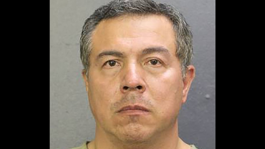 George Hernandez, 53, allegedly stabbed his wife in a shopping center parking lot Tuesday.