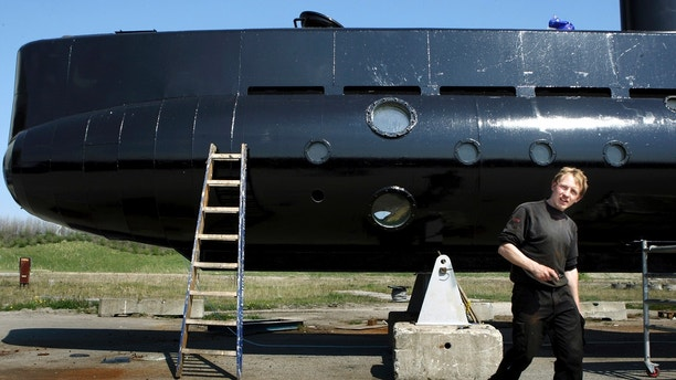 FILE - This April 30, 2008 file photo shows a submarine and its owner Peter Madsen. Peter Madsen stands trial at Copenhagen's City Court on Thursday March 8, 2018, for the killing of Kim Wall, 30, in his submarine off the usually quiet northern European country. (Niels Hougaard/Ritzau via AP, File)