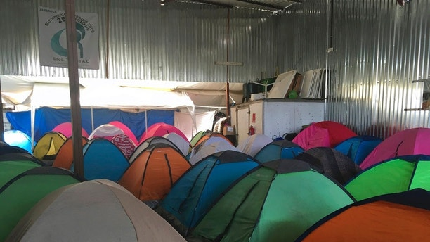 "Temporary tents for about 130 middle-Americans, mostly women and Children who arrived in a ""caravan"" of asylum-seeking immigrants to the US border with Mexico, which has drawn the anger of President Donald Trump, were seen on Tuesday, April 24, 2018, at a shelter in Tijuana, Mexico. Two busloads arrived late Tuesday in the Mexican border town of Tijuana and another 200 were expected. Legal workshops are scheduled for this week and the first large group is expected to enter the US on Sunday at a San Diego border crossing. in San Diego, California (AP Photo / Elliot Spagat)"