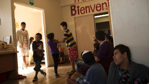 Central American migrants traveling with a caravan wait to be registered at the Viña de Cristo shelter in Tijuana, Mexico, Wednesday, April 25, 2018. The caravan of mainly Central American migrants are planning to request asylum, either in the United States or Mexico. (AP Photo/Hans-Maximo Musielik)