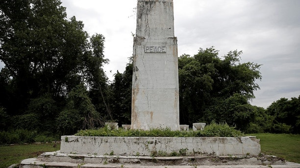 "A crumbling peace monument, built in 1948 by former inmates, stands on Hart Island, the former location of a prison and hospital that is a potter's field burial site of as many as one million people, New York, United States June 23, 2016. REUTERS/Mike Segar SEARCH ""PAUPERS GRAVE"" FOR THIS STORY. SEARCH ""THE WIDER IMAGE"" FOR ALL STORIES.  - S1AETMJUKSAA"