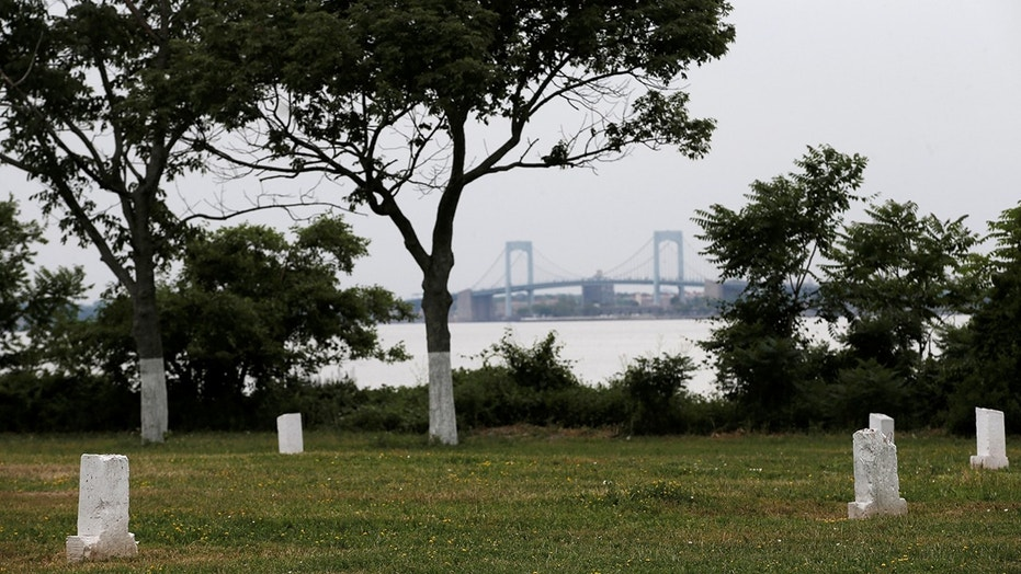 Human bones were exposed on Hart Island due to beach erosion.