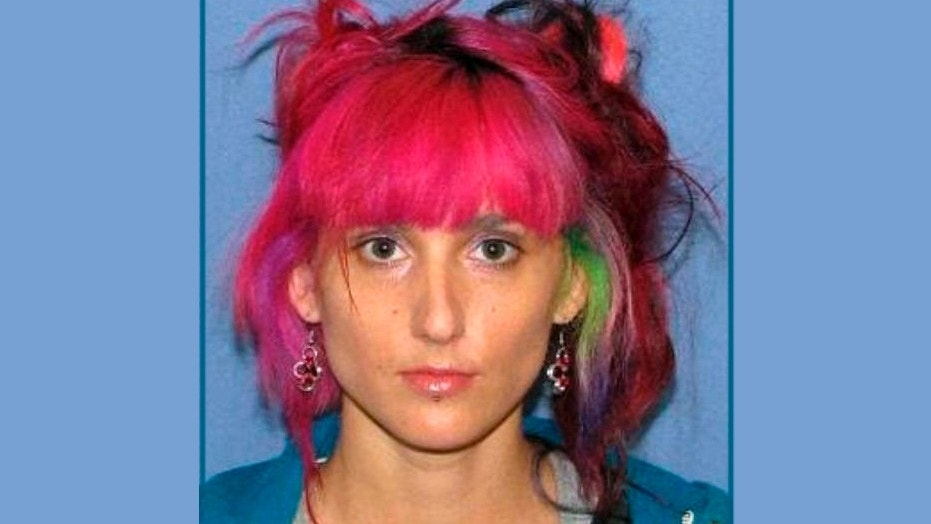 Jamie Revis, 36, was arrested for allegedly stealing a rare blue butterfly.