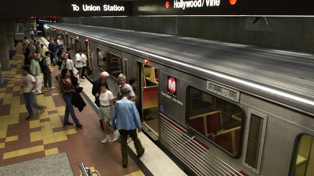 Some of the first fare paying passengers get off a Metro Red Line subway train at the Hollywood and Vine station in Hollywood June 14. The latest $1.74 billion portion of the Los Angeles subway system to open connects downtown Los Angeles and Hollywood in a 15 minute ride.