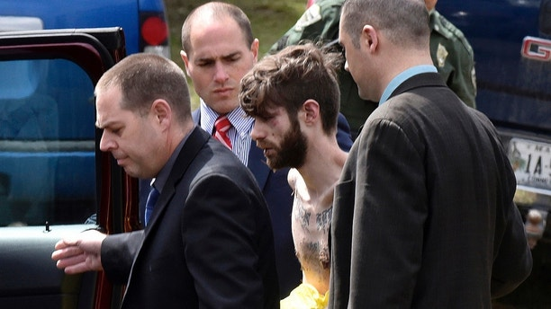 Maine State Police detectives lead John Williams to a police cruiser Saturday, April 28, 2018, on Norridgewock Road in Fairfield, Maine, following a four-day manhunt. Williams was wanted in the fatal shooting of Somerset County Deputy Sheriff Eugene Cole early Wednesday after the two had an encounter on a darkened roadside in Norridgewock. Officials said the 29-year-old Madison man also stole Cole's cruiser and robbed a convenience store. (David Leaming/Waterville Morning Sentinel via AP) MANDATORY CREDIT