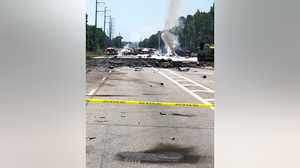 Emergency personnel work at the scene of an Air National Guard C-130 cargo plane that crashed near Savannah, Ga., Wednesday, May 2, 2018. (Chris Hanks/Savannah Professional Firefighters Association via AP)