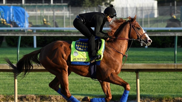 An exercise rider works out Kentucky Derby hopeful Justify at Churchill Downs in Louisville, Kentucky, U.S., May 1, 2018.    Mandatory Credit: Jamie Rhodes-USA TODAY Sports?? - RC172D930560