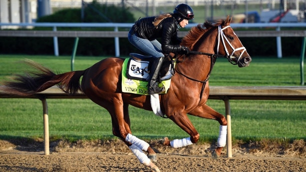 May 1, 2018; Louisville, KY, USA;  Exercise rider Adelle Bellinger works out Kentucky Derby hopeful Vino Rosso at Churchill Downs. Mandatory Credit: Jamie Rhodes-USA TODAY Sports - 10815938