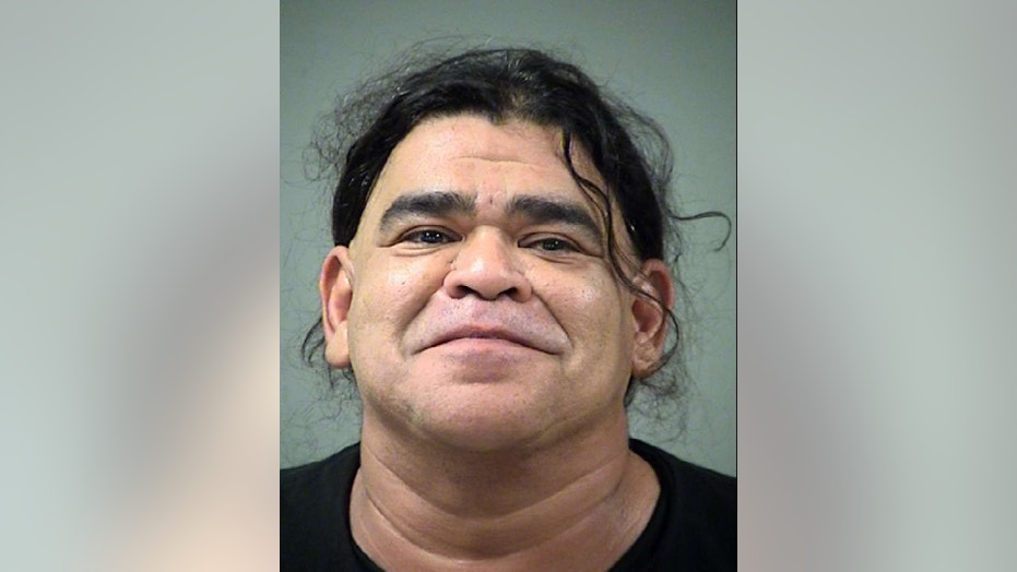 Motel employee Manuel Romo, 49, tipped off an unnamed fugitive about police surveillance, authorities said.