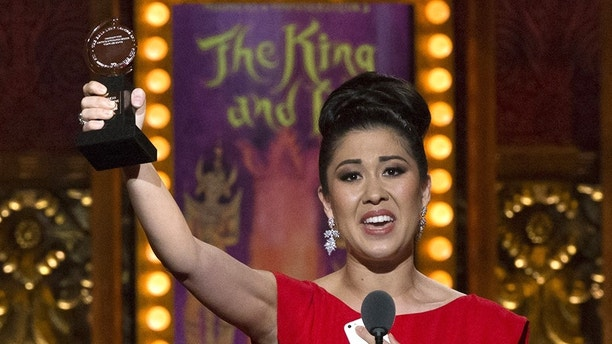 """Ruthie Ann Miles accepts the award for Best Performance by an Actress in a Featured Role in a Musical for """"The King and I"""" during the American Theatre Wing's 69th Annual Tony Awards at the Radio City Music Hall in Manhattan, New York June 7, 2015.  REUTERS/Lucas Jackson - TB3EB680DTA4L"""