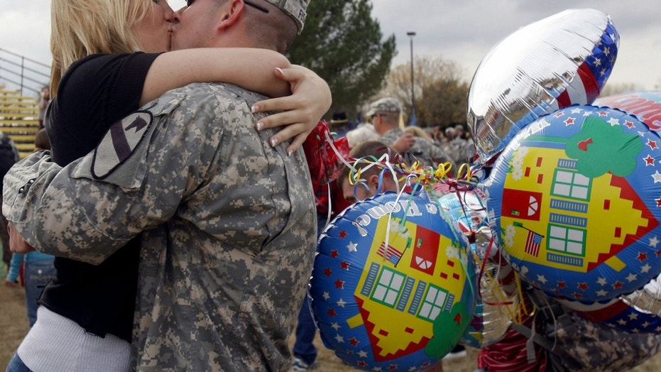 Spc. Andrew Fisk, of the First Calvary Division, kisses his wife Meisha, at a homecoming ceremony in Fort Hood, Texas, Dec. 19, 2007.