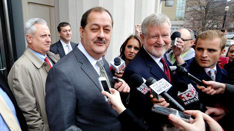 Former Massey Energy Chief Executive Don Blankenship (3rd L) and his attorney Bill Taylor (4th R) are met by media outside the Robert C. Byrd U.S. Courthouse in Charleston, West Virginia December 3, 2015. Blankenship was found guilty in federal court on Thursday of conspiring to violate safety standards at the Upper Big Branch mine, the site of a 2010 blast that killed 29 people.    REUTERS/Chris Tilley - TM3EBC311Q601