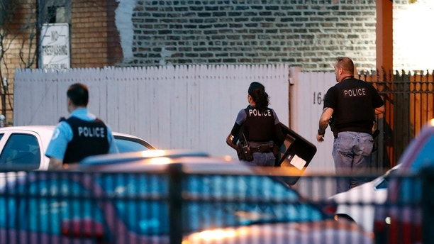 Chicago police work the scene near the area where a federal agent was shot and critically wounded in Chicago while working on an investigation with local authorities on Friday, May 4, 2018.    A Chicago police spokesman says the Bureau of Alcohol, Tobacco, Firearms and Explosives agent was working with Chicago officers at the time of the shooting about 3:15 a.m. Friday on the city's South Side. No arrests have been reported.    (Jose M. Osorio/Chicago Tribune via AP)