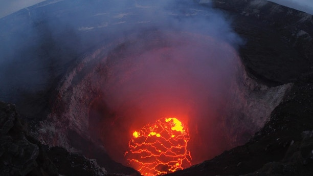 This May 6, 2018 photo provided by the U.S. Geological Survey shows the lava lake at the summit of Kilauea near Pahoa, Hawaii. Hawaii's erupting Kilauea volcano has destroyed homes and forced the evacuations of more than a thousand people. (U.S. Geological Survey via AP)