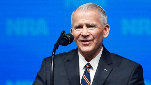 In this May 4, 2018 photo, former U.S. Marine Lt. Col. Oliver North speaks before giving the Invocation at the National Rifle Association-Institute for Legislative Action Leadership Forum in Dallas. The NRA announced today that North will become President of the National Rifle Association of America within a few weeks, a process the NRA Board of Directors initiated this morning. (AP Photo/Sue Ogrocki)
