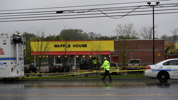 Metro Davidson County Police inspect the scene of a fatal shooting at a Waffle House restaurant near Nashville, Tennessee, U.S., April 22, 2018.  REUTERS/Harrison McClary - RC187E950B00