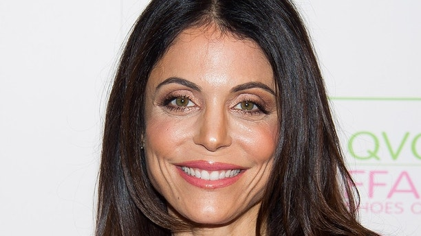 """Bethenny Frankel attends the QVC and FFANY Present The """"FFANY Shoes on Sale"""" Gala on Wednesday, Oct. 8, 2014, in New York. (Photo by Charles Sykes/Invision/AP)"""
