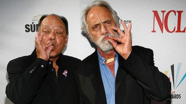 """Actors Cheech Marin (L) and Tommy Chong gesture as they arrive for the taping of the 2008 """"NCLR Alma"""" awards at the Civic Auditorium in Pasadena, California, August 17, 2008. The National Council of La Raza (NCLR) gives out the ALMA awards to honor outstanding Latino artistic achievement in television, film and music. The show airs September 12 on ABC.  REUTERS/Mario Anzuoni   (UNITED STATES) - GM1E48I1I5E01"""