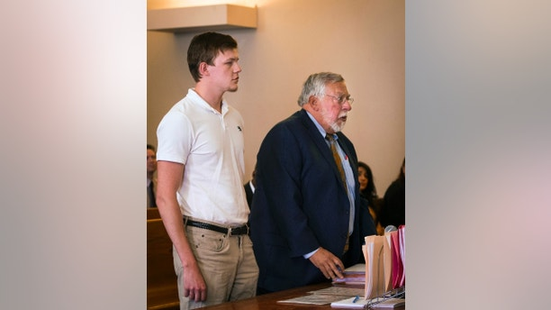 Ryan Fish stands with his  lawyer, Paul Chinigo, in Norwich Superior Court on Tuesday, May 8, 2018 in Norwich, Conn.  Fish  faces two counts of risk of injury to a child, four counts of second-degree reckless endangerment and one count of second degree breach of peace. (Melanie Stengel/Hartford Courant via AP)