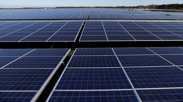 FILE PHOTO: File photo shows a general view of solar panels used to produce renewable energy at the photovoltaic park in Cestas, France, December 1, 2015.  REUTERS/Regis Duvignau//File Photo - RC139B3CB920