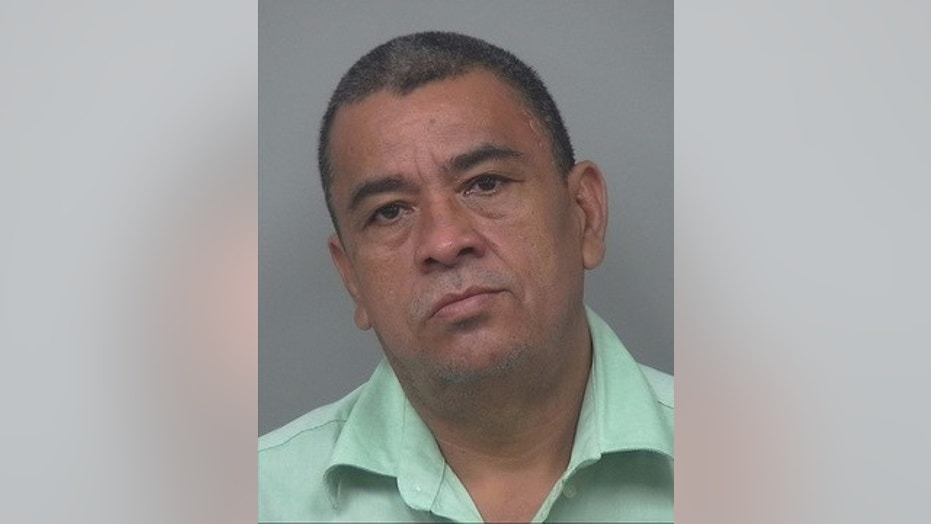 Hector Ulises Garay, 51, was taken into custody Tuesday in El Salvador in connection with a 1996 shooting death in Georgia, the FBI said.