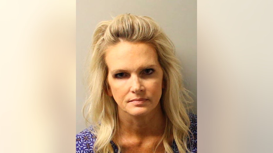 Denise Williams, 48, was arrested Tuesday on charges of first-degree murder, conspiracy to commit murder and accessory after the fact in her husband Mike Williams' December 2000 killing.