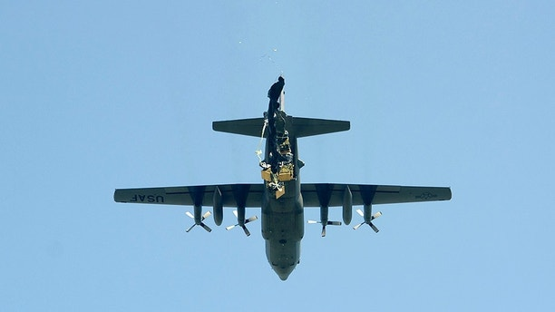 A C-130 Hercules aircraft carrying Humvees, Howitzers and supply containers with ammunition, conducted a heavy equipment drop July 21, 2017, in Campia Turzii, Romania in support of Saber Guardian. Saber Guardian 17 is an exercise under the U.S. European Command's Joint Exercise Program, executed by U.S. Army Europe. It enhances joint and combined interoperability across a full spectrum of mission sets between Bulgaria, Hungary and Romania. This multinational training exercise improves the professional relationships and the overall coordination between NATO Allies and regional partners. (U.S. Army photo by Sgt. Justin Geiger)