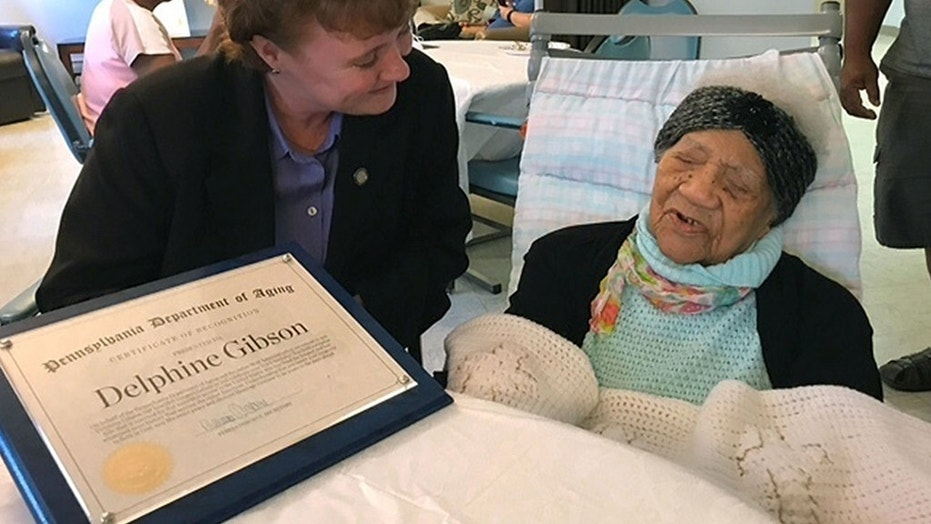 In this photo provided by Pennsylvania's Department of Aging, Delphine Gibson, right, is visited by Aging Secretary Teresa Osborne, at AristaCare Thursday, Aug. 17, 2017, in Huntingdon Park, Pa. Gibson, the oldest known living person in the United States, died Wednesday.